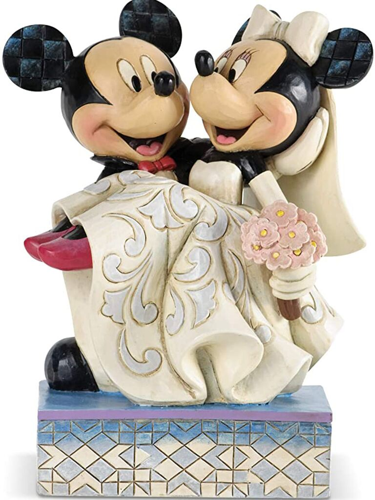 Resin Mickey holding Minnie in wedding attire on blue and white geometric tile stand