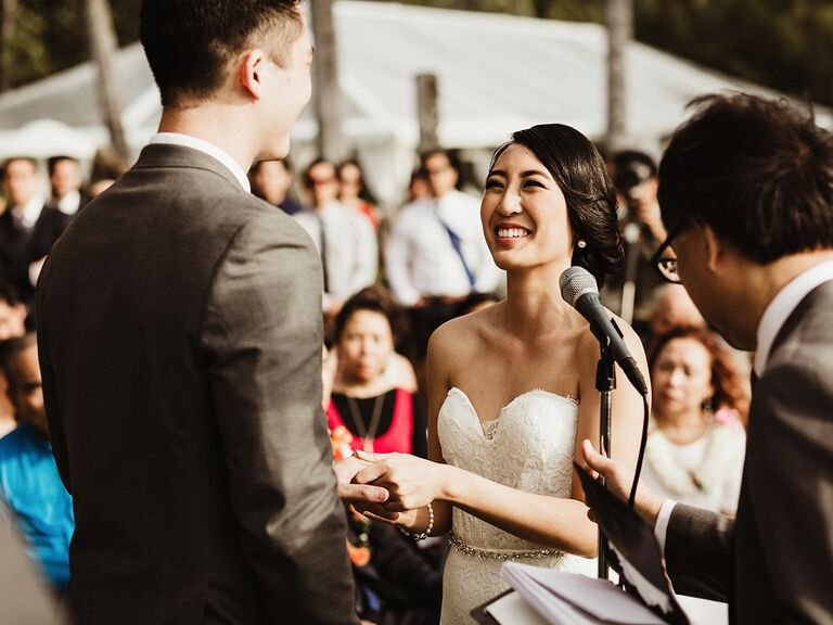Couple reading vows at wedding ceremony