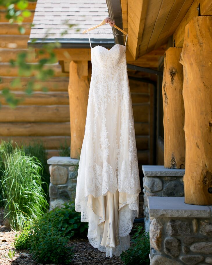 The bride wore a vintage ivory lace wedding dress complete with a champagne gold underlay. To finish the look, she paired the vintage find with ivory Tom's wedges.