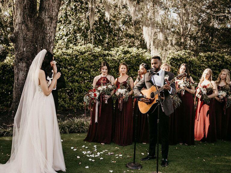 friends themed wedding groom serenading bride