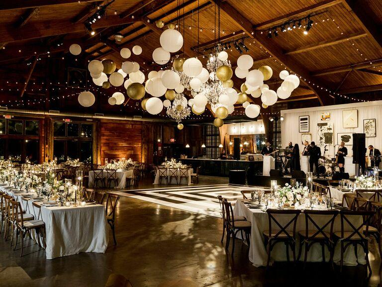 Rustic barn wedding venue with balloon installation on ceiling