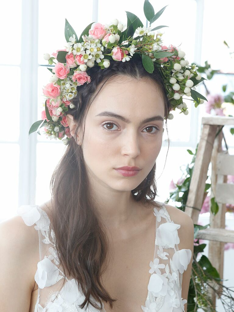 Half-up wedding hairstyle with a boho flower crown