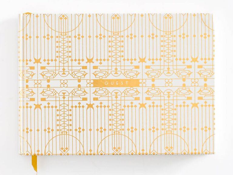paper source gold patterned wedding guest book idea