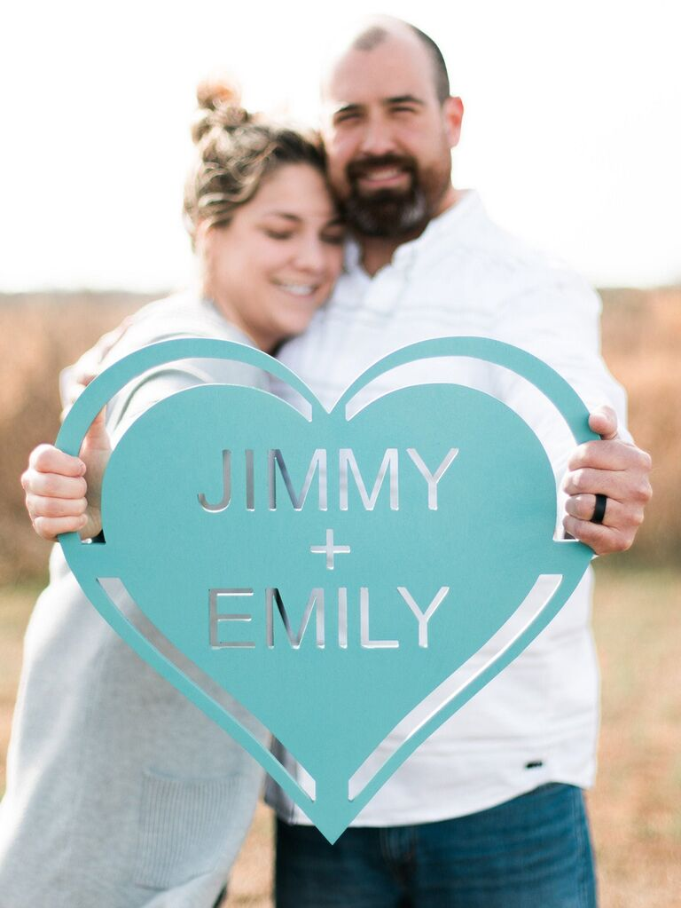 Teal wooden heart with cutouts and couple's names