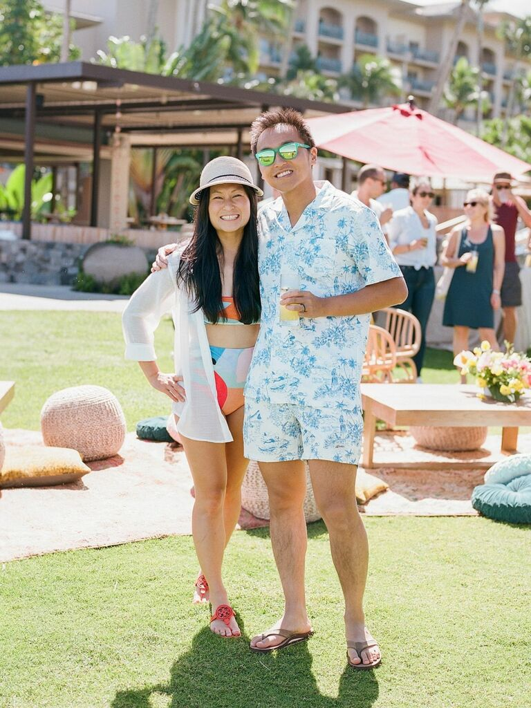 couple dressed in swimsuits at post-wedding pool day