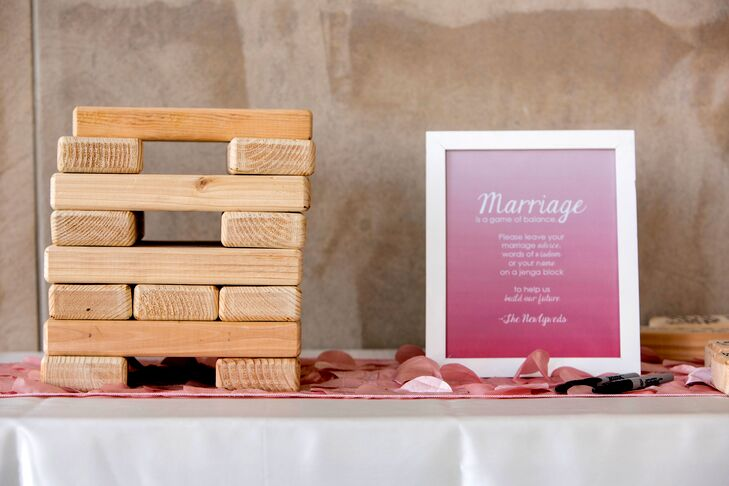 The bride and groom made cootie catchers as their program so guests could get to know us and our bridal party. Their guest book was a giant Jenga set the bride's dad made for the groom. They had guests sign blocks to create a fun souvenir of their wedding day.