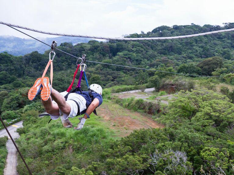 Man ziplining over the treetops in Costa Rica