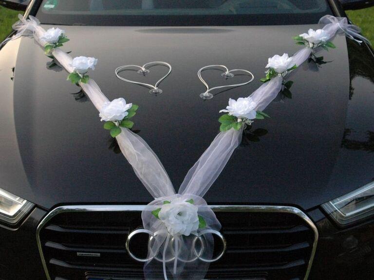 Organza ribbon on hood of car