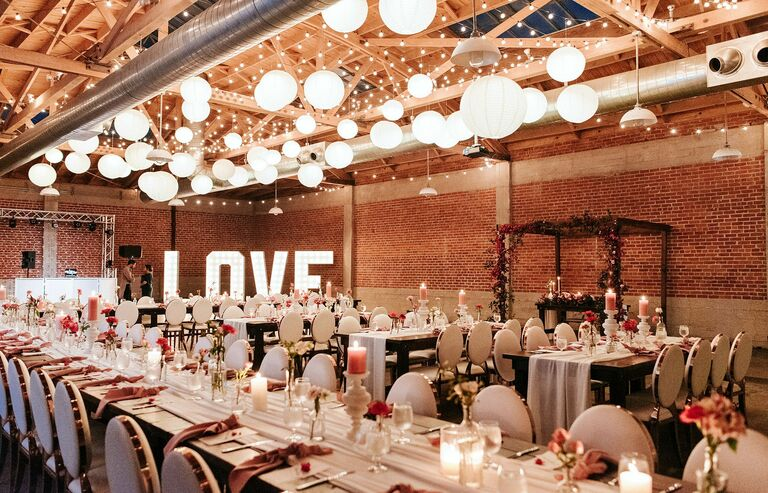 Loft wedding reception with paper lanterns and marquee letters
