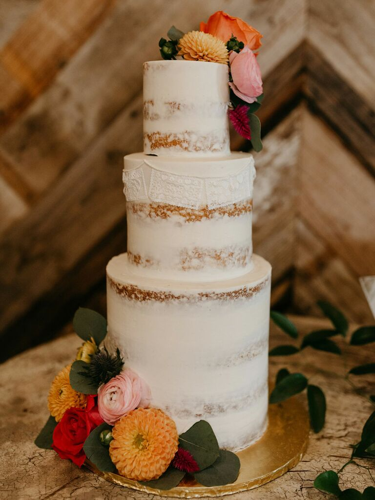 Rustic wedding cake with white semi-naked icing and mismatched tier heights