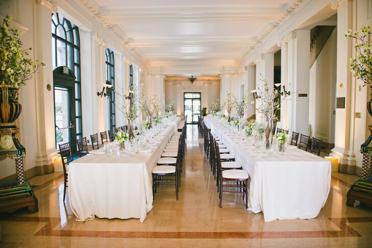 """Knowing that formal affairs run the risk of feeling stuffy, Margot and Ricky worked with the wedding pros at Pine Street Events to make sure their day was anything but. The pair put a contemporary spin the James Leary Flood Mansion's ornate interiors with decidedly modern floral arrangements in brilliant shades of white and green, playful place settings complete with gilded animal place card holders and signature drinks like Corona and lime. """"Because our venue was so formal and because we are a pretty low-key couple in general, we purposefully chose less formal table settings, flowers, and linens to create a high-low dynamic,"""" says Margot."""