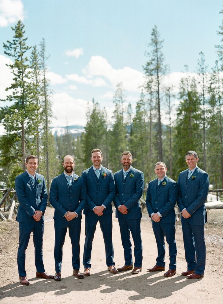 The men in the wedding party wore three-piece custom suits with a camouflage liner and personalized monogramming.