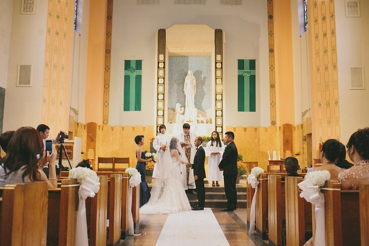 Rhea and Daryl married in an intimate church ceremony just around the corner from the bride's mother's home. The two even incorporated classic Filipino traditions, included the exchanging of coins and the release of doves upon exiting the church.