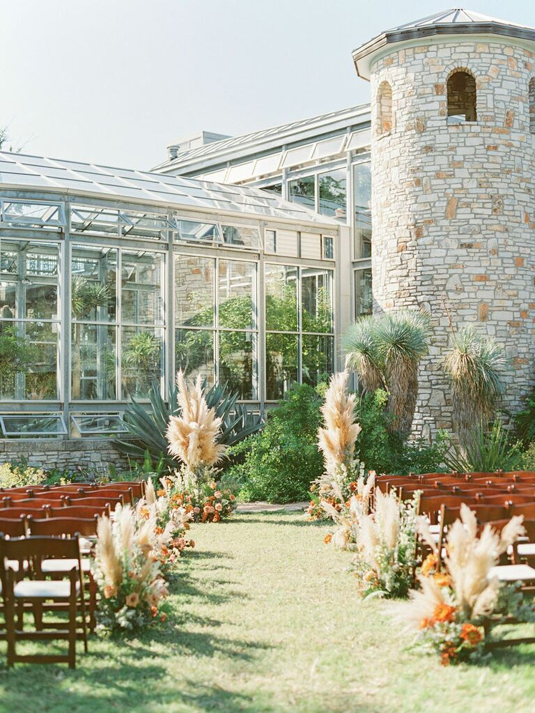 Outdoor boho wedding theme and style with pampas grass arrangements