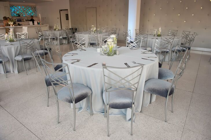 Modern silver cross-back chairs added an edgy, contemporary vibe to the classic white dining tables.
