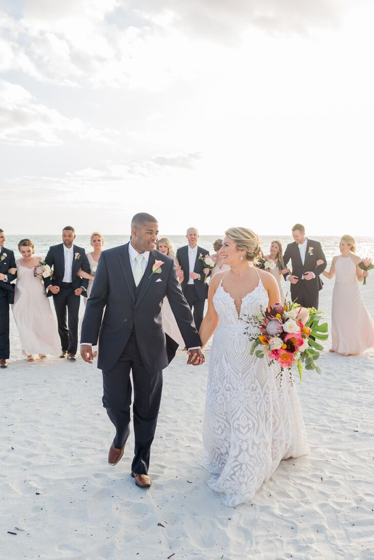 Ashton Henderson and Marc Theodore tied the knot with a bright, tropical fete at the Marco Beach Ocean Resort, where they got engaged. The pair exchan