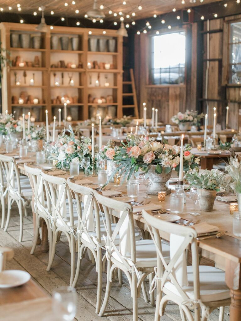 Rustic barn reception with wood cross-back chairs