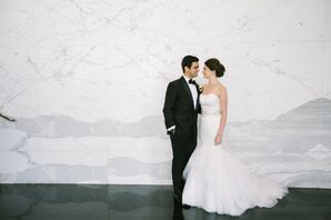 Bride and Groom in Front of Marble Wall