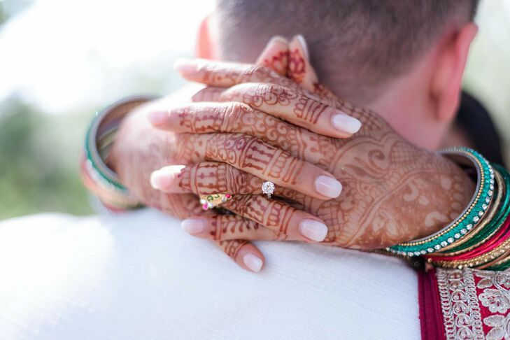 Hand With Henna and Engagement Ring