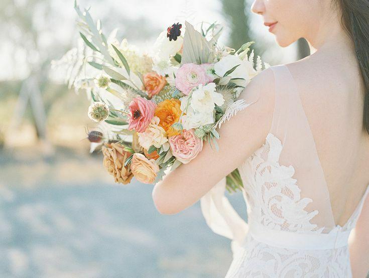 Bride holding wildflower-inspired bouquet in the desert