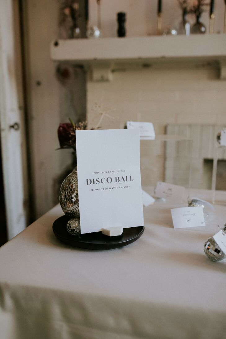 Disco Ball Escort Cards with Simple Signs