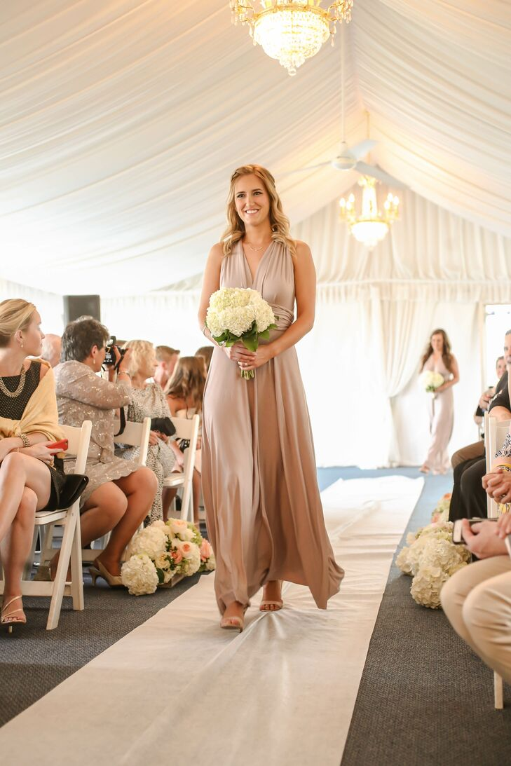 Alina and Nick paid a subtle tribute to Florida with their wedding colors. Each bridesmaids wore a flowing floor-length dress from Lulusa.com in a neutral tone to represent the sandy beaches. The green leaves beneath their white hydrangea bouquets also symbolized the state's natural landscapes, for the couple.