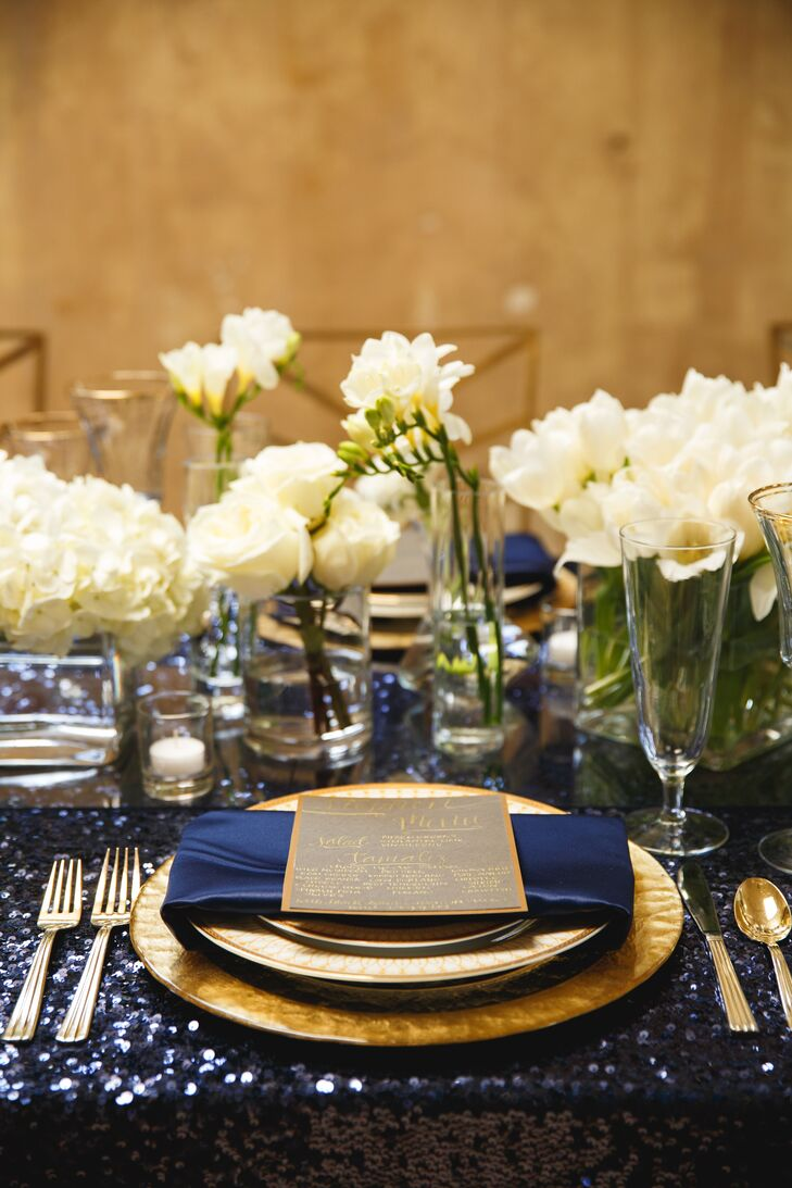"""""""Our look was strong on the jewel tones,"""" says Angela. """"We lightened up the ambiance with all-white flowers and a touch of glass and sparkle."""