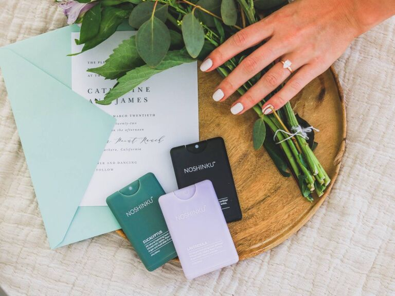 Three pocket hand sanitizers on table at wedding
