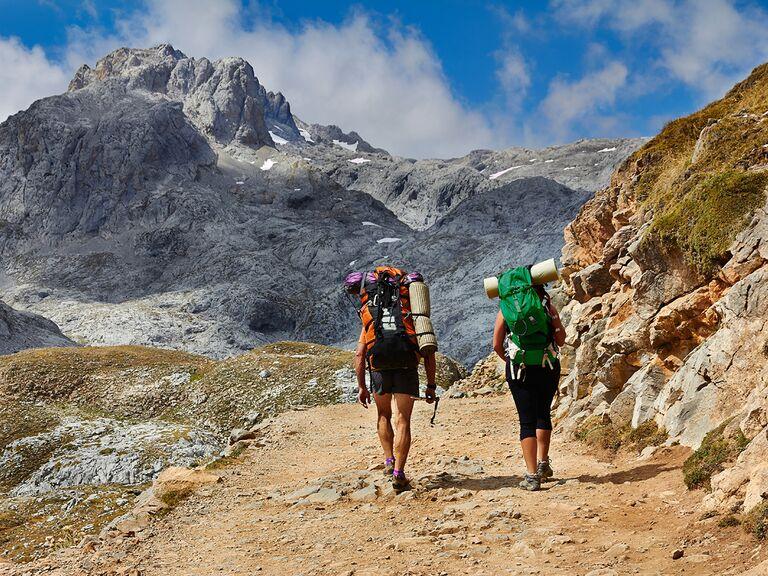 Couple trekking in High mountains of Picos de Europa, Cantabria, Spain.
