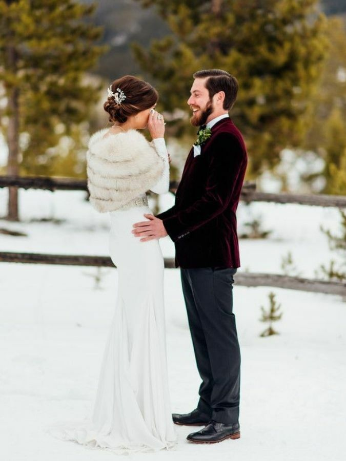 Couple sharing first look in the snow