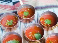 Wedding reception appetizer of mini gazpacho soups