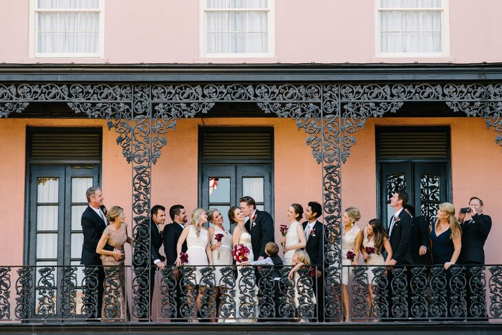 Jaclyn opted for neutral lace bridesmaid dresses because she didn't want her color palette to be restricted to whatever tone she settled on for their dresses. Instead, she added a pop of color through their burgundy bouquets.