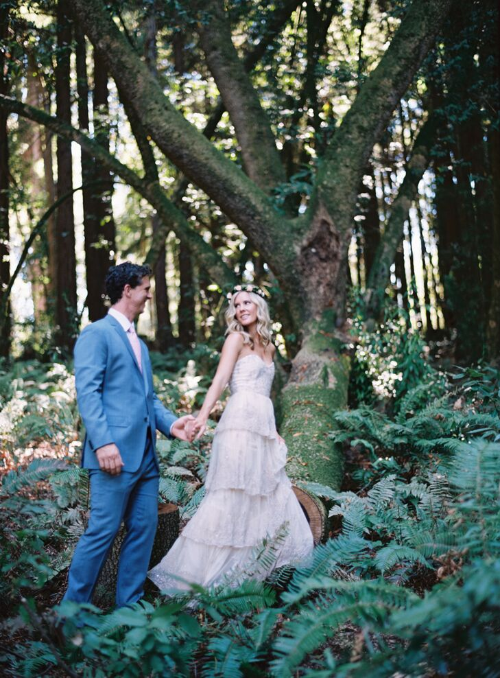 Twinkling market lights, elegant lounge furniture and a romantic palette created an enchanted forest feel at this formal backyard wedding, surrounded