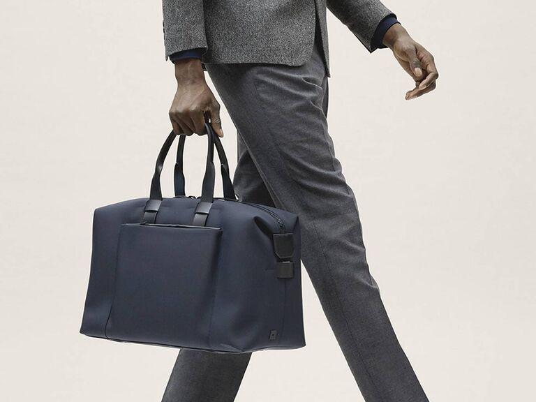 Man carrying sleek and minimalist weekender