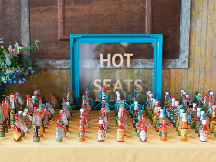 Escort card table with hot sauce favors