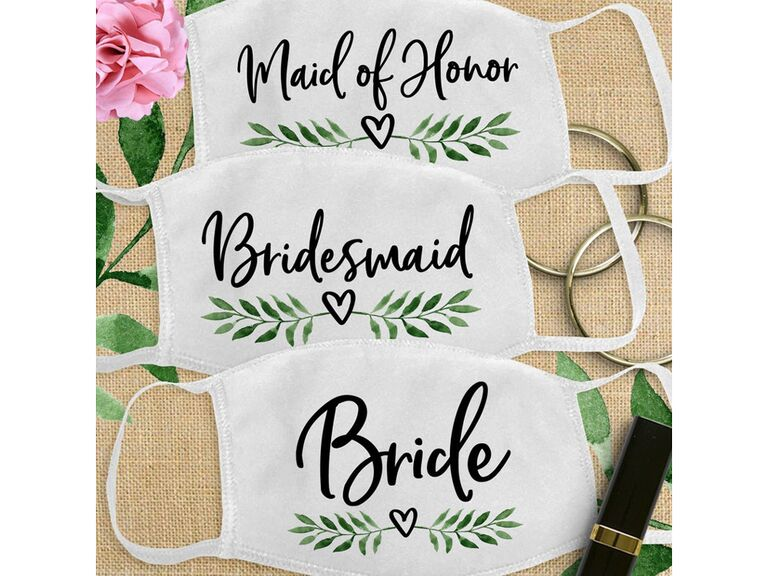Wedding party face masks with floral leaf print and titles