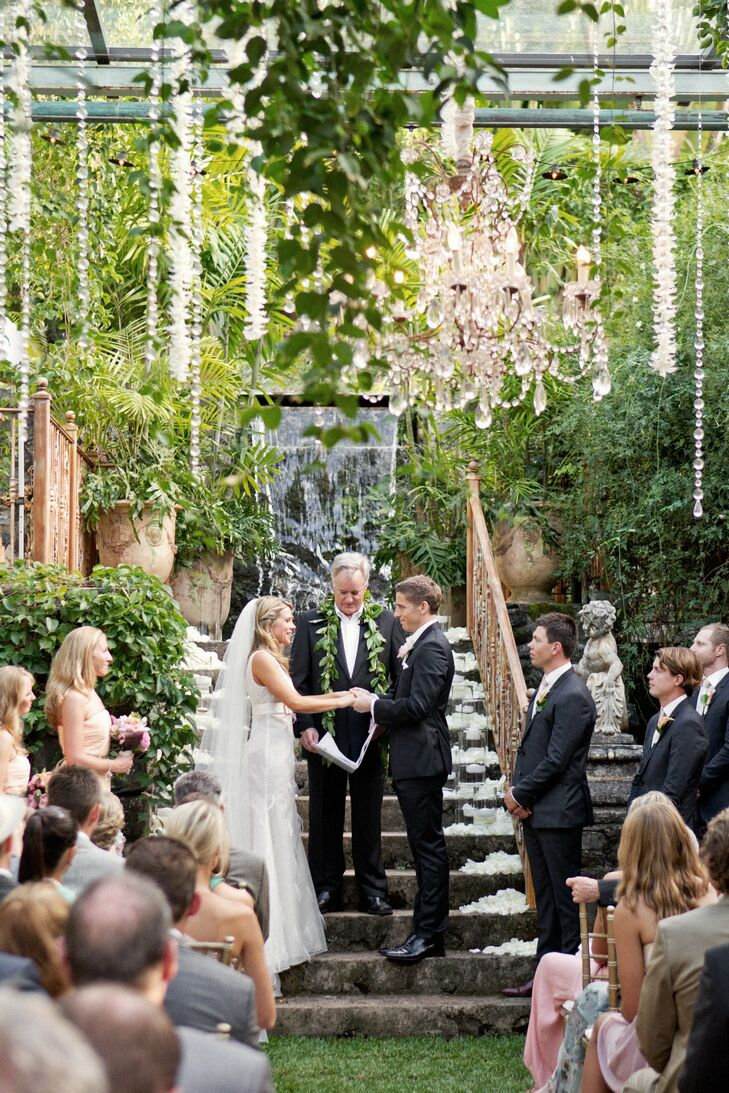 Since the ceremony and reception took place at Haiku Mill (an old sugar mill in Haiku, HI), the couple was surrounded with lush island greenery, waterfalls and their own elegant touches during their marriage vows.