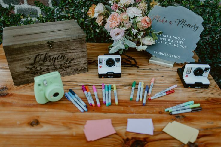 Table with pens and Polaroid cameras