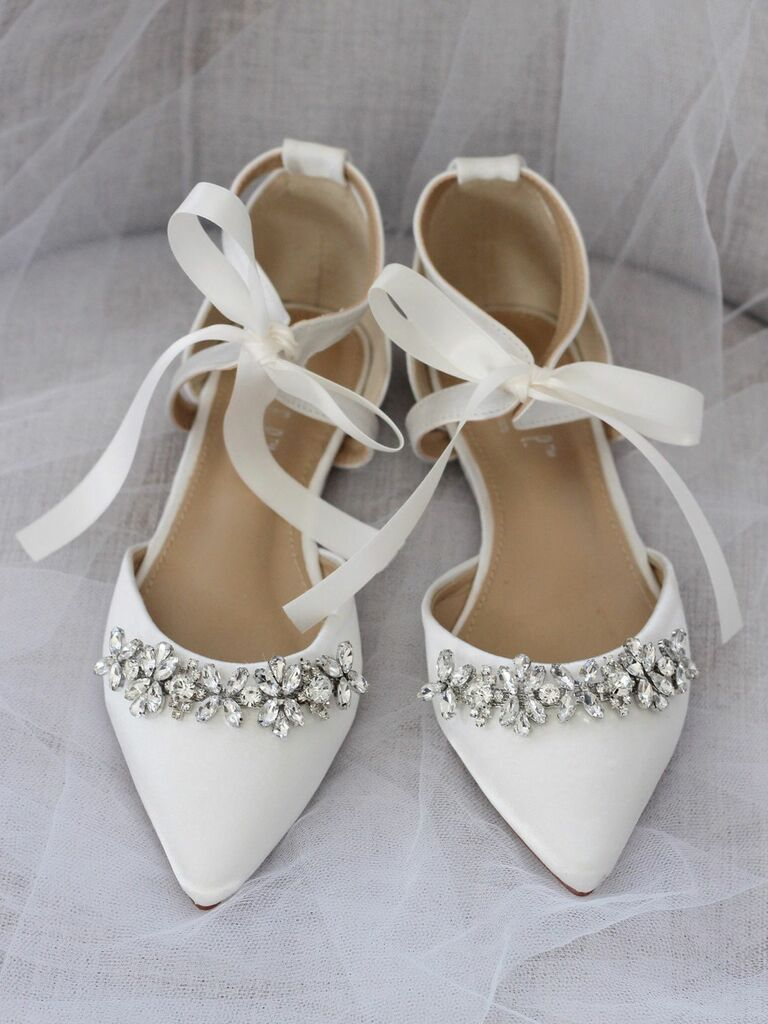 white pointed toe flats with embellishment