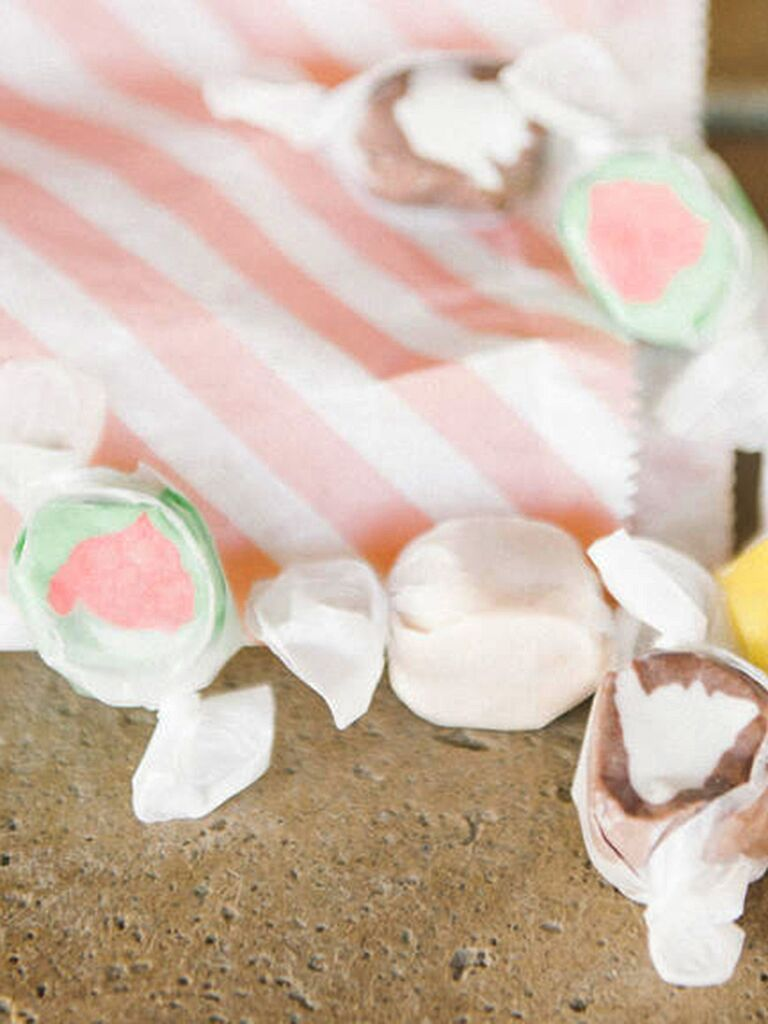 Saltwater taffy wedding favors in pink striped bag