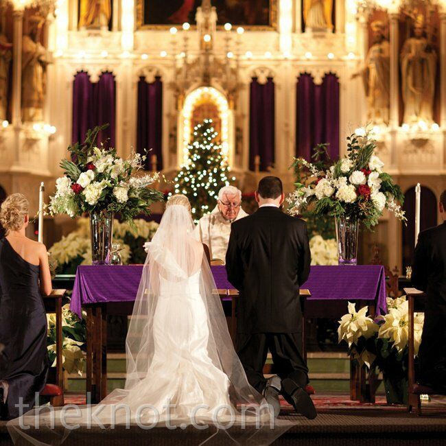 Holy Family Church, which is associated with the high school Katie and Matt attended, was already decorated for Christmas, so the couple brought in just two lush white-andred floral arrangements.