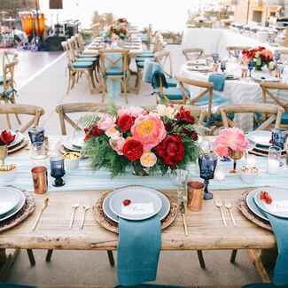 Outdoor wedding reception with colorful table settings