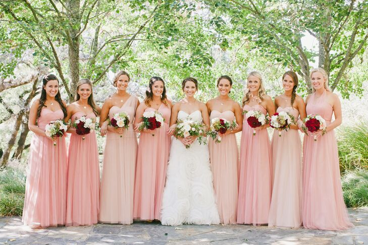Nicki's bridesmaids were the picture of romance in blush floor-length chiffon gowns by Jenny Yoo. The convertible style allowed the girls to customize their look, while varying shades of blush created an ombre effect.