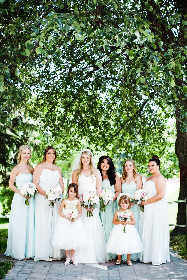 While Jillian's bridesmaids wore matching dresses, she chose a variety of soft pastel hues to go with their coloring and styles. The floor-length Donna Morgan gowns featured a strapless sweetheart neckline that mirrored the one on Jillian's own dress and came in shades of mint, candy apple and beach glass.