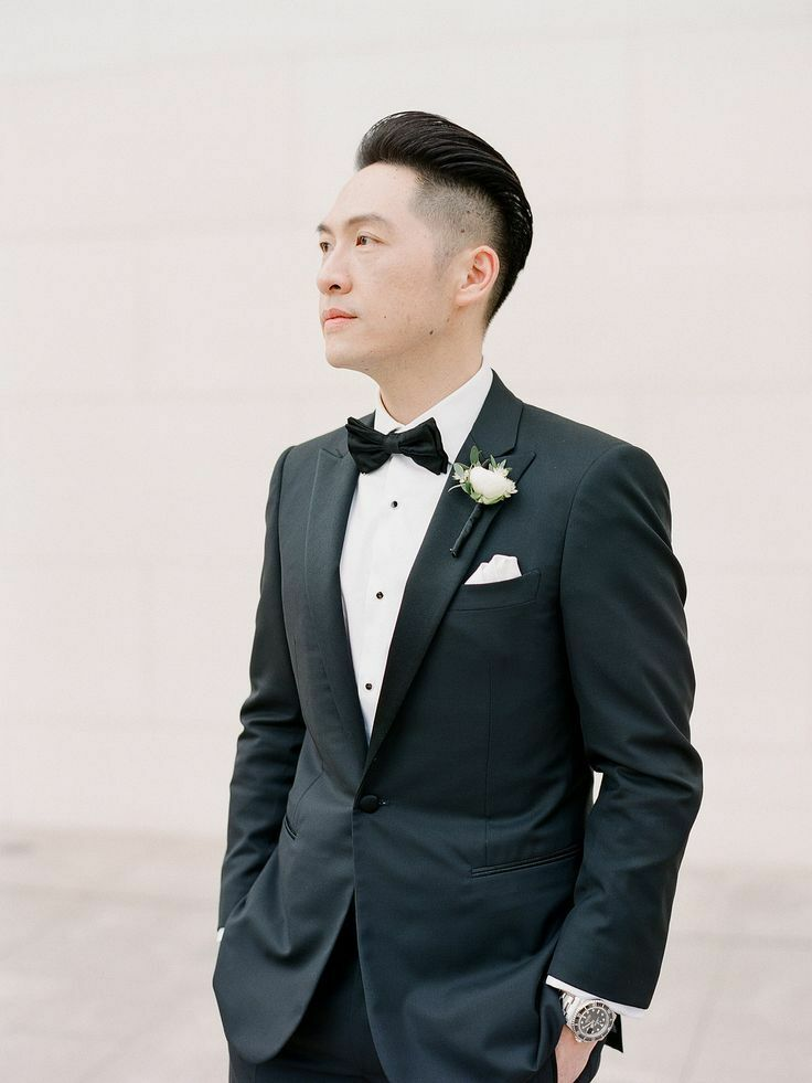Groom in tux with white boutonniere