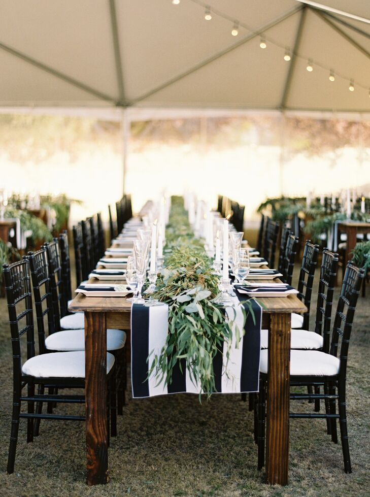 """Inside the clear tent, long farm-style tables were topped with succulents and a simple black-and-white-striped table runner. """"I wanted an atmosphere that was elegant but natural and rustic,"""" Danika says. """"My wedding planner, Shannon Hough, combined those elements beautifully."""""""