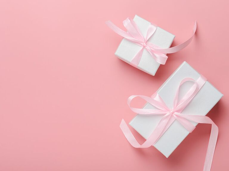 Wrapped bridal shower gift and wedding gift with pink bows