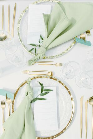 Gold-and-Green Place Setting for Wedding at Savoia Castle in Prague, Czech Republic