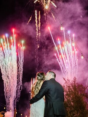 Couple Kissing During Post-Wedding Fireworks