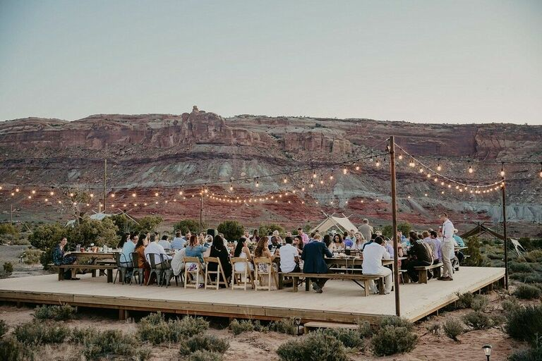 Sunset reception in the desert with string lights